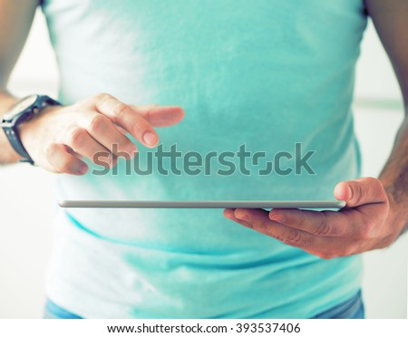 Man working with tablet computer - stock photo
