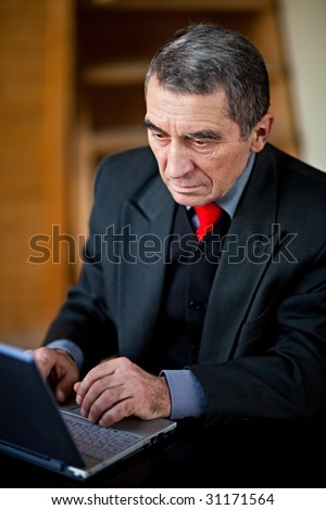 Man works on laptop