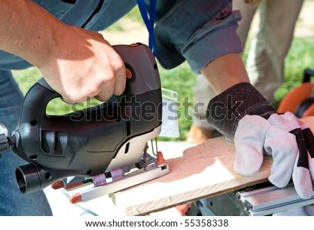 Man works with portable plane - stock photo