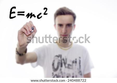 Man writes mathematical equations on whiteboard - stock photo