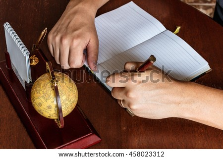 man writes with his left hand in the diary entries. left-handed