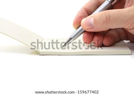 man writing in his reminder - stock photo