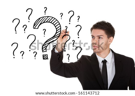 Man writing lots of questions on white screen - stock photo