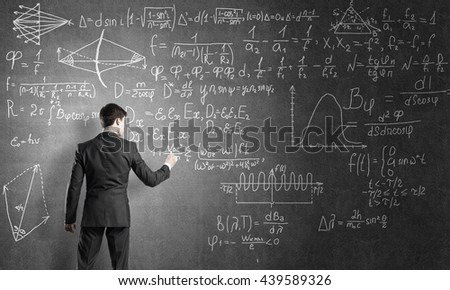 Man writing on blackboard
