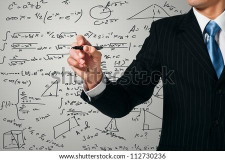 Man writing on the screen. Mathematics - stock photo