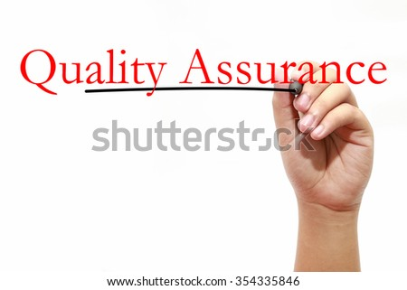 Man writing text Quality Assurance over white - stock photo