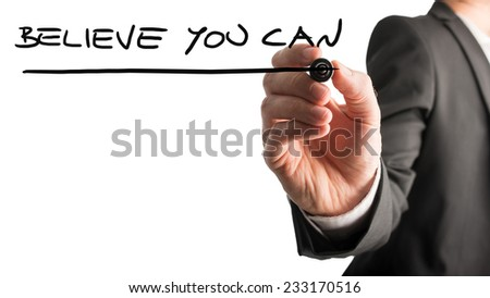 Man writing the idiom Believe you can on a virtual interface with a black marker pen over white with copyspace in a motivational message. - stock photo