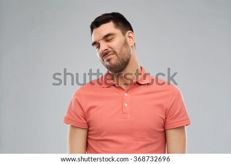 man wrying over gray background - stock photo