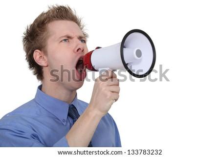 Man yelling into a megaphone - stock photo