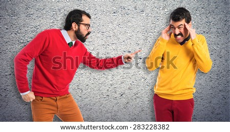 man yelling to his brother over colorful background - stock photo