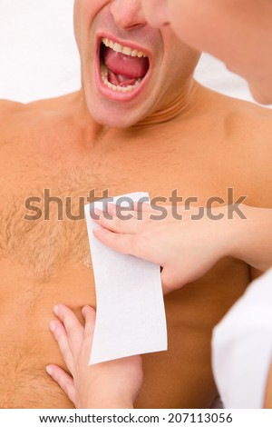Man yelling while waxing - stock photo