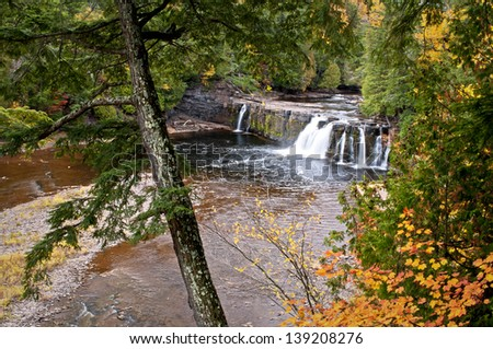 Manabezho Autumn Fall color at Manabezho Falls on the Presque Isle River, Porcupine Mountain Wilderness State Park, Michigan. - stock photo