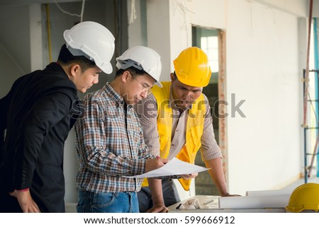 Management consulting engineers foreman working blueprint stock management consulting and engineers and foreman working with blueprint and drawing on work table for management malvernweather Image collections