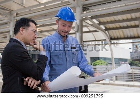 Management consulting engineers working hard hat stock photo management consulting with engineers working with hard hat and holding blueprint for management business plan malvernweather Choice Image
