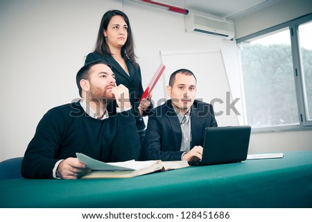 Manager and his team in the office,Italy - stock photo