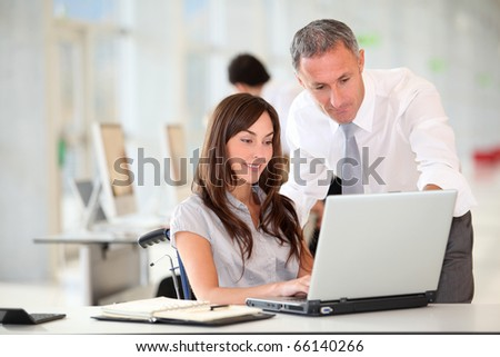 Manager and office worker in wheelchair - stock photo