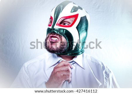 Manager, angry businessman with Mexican wrestler mask, expressions of anger and rage - stock photo
