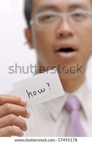 Manager ask you ??how?? and holding one card with words. - stock photo