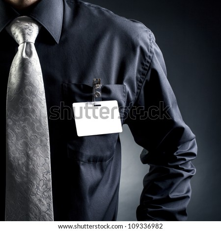 Manager.  Badge at the forefront - stock photo