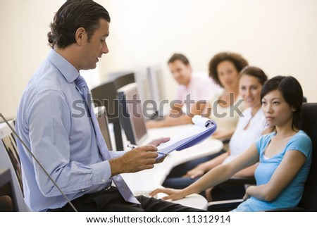 Manager briefing office staff - stock photo