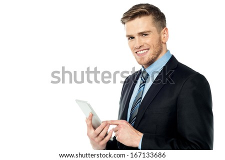 Manager browsing on tablet device - stock photo