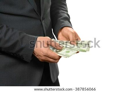 Manager counts cash. All for himself. Hide or share. Must concentrate. - stock photo