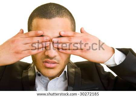 Manager holding his hands in front of his eyes - stock photo