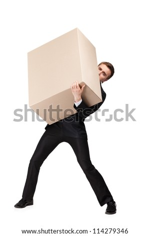 Manager in suit bears a huge cardboard box, isolated on white
