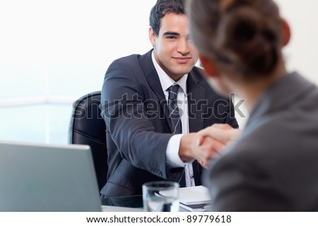 Manager interviewing a female applicant in his office - stock photo