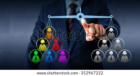 Manager is comparing a multicolored work team versus a plain gray one. His index finger is keeping a virtual balance in equilibrium. Business concept for multicultural organization and diversity. - stock photo