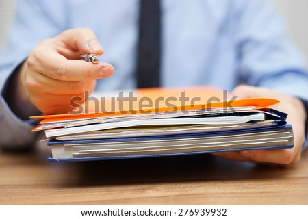 manager is offering you pen and  to take the documentation to begin with work - stock photo