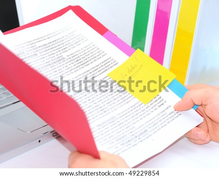 Manager is reading a contract with notes - stock photo