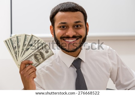 Manager keeps the dollars in hand. Clerk received a salary. - stock photo
