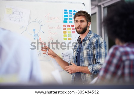 Manager Leading Creative Brainstorming Meeting In Office - stock photo