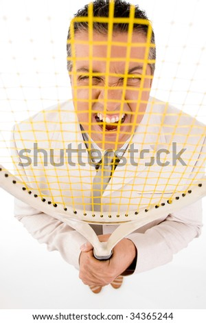 Manager looking through tennis racket - stock photo