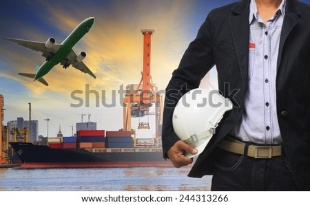 manager man holding safety helmet standing against ship and container on shipping port and cargo plane flying above use for freight and logistic transport industry - stock photo