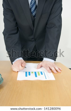 Manager Presenting Graph and Pointing towards with Pen