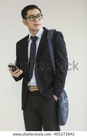 manager standing and phoning - stock photo