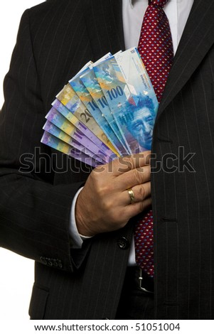 Manager, Swiss franc notes in his hand - stock photo