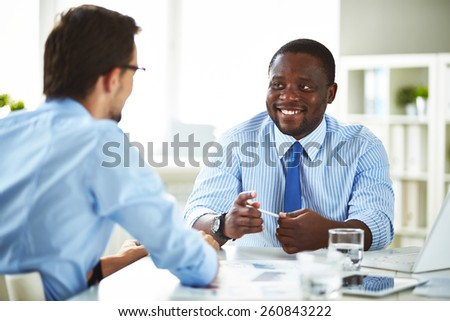 Manager talking to a new employee - stock photo