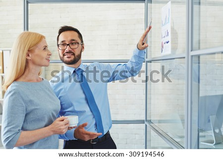 Manager talking to his chief about new strategy - stock photo