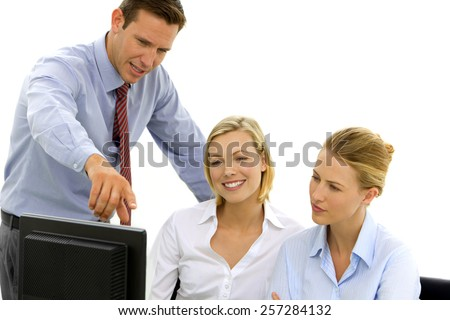 Manager training employees to use computer - stock photo