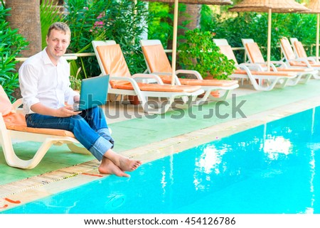 Manager with a laptop smiling and working - stock photo