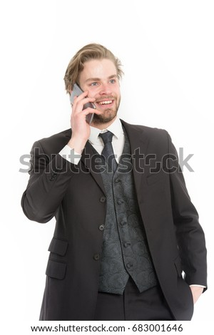Manager with beard on smiling face. Businessman or ceo in black jacket. Man in formal outfit with mobile phone. Business fashion and success. Conversation and new technology.