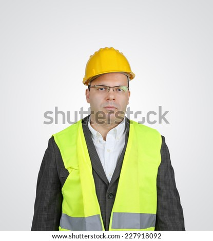 Manager with safety vest and hard hat