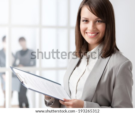 Manager with tablet on the glass wall background with people - stock photo