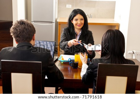 Manager woman giving an agreement to sign to a hired woman at job interview