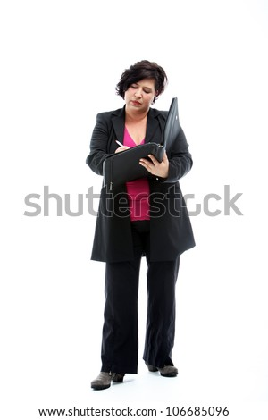 Manageress or senior female executive standing concentrating on writing notes in a leather folder isolated on white - stock photo