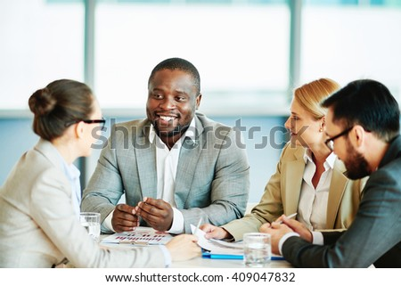 Managers at meeting with entrepreneur - stock photo
