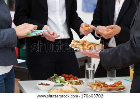 Managers meeting with healthy food in office - stock photo